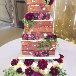 Naked cake with gold leaf details