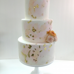 Watercolor cake with gold leaf