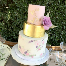 Hand painted wedding cake with gold leaf