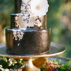 Black fondant cake with gold leaf