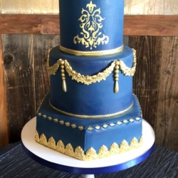Navy blue and gold fondant cake