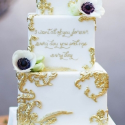 Fondant wedding cake with gold details