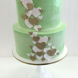Buttercream baby shower cake with fondant details