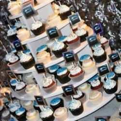 Custom event order featuring 300 cupcakes topped with custom made flags
