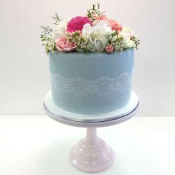 Fondant bridal shower cake with fresh flowers