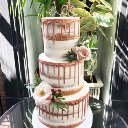 Semi-naked buttercream with chocolate drip (painted rose gold)